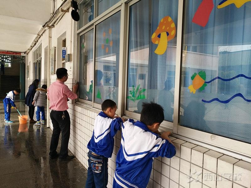 师生齐动手 创造美丽校园—江西省西山学校小学部开展卫生大扫除活动